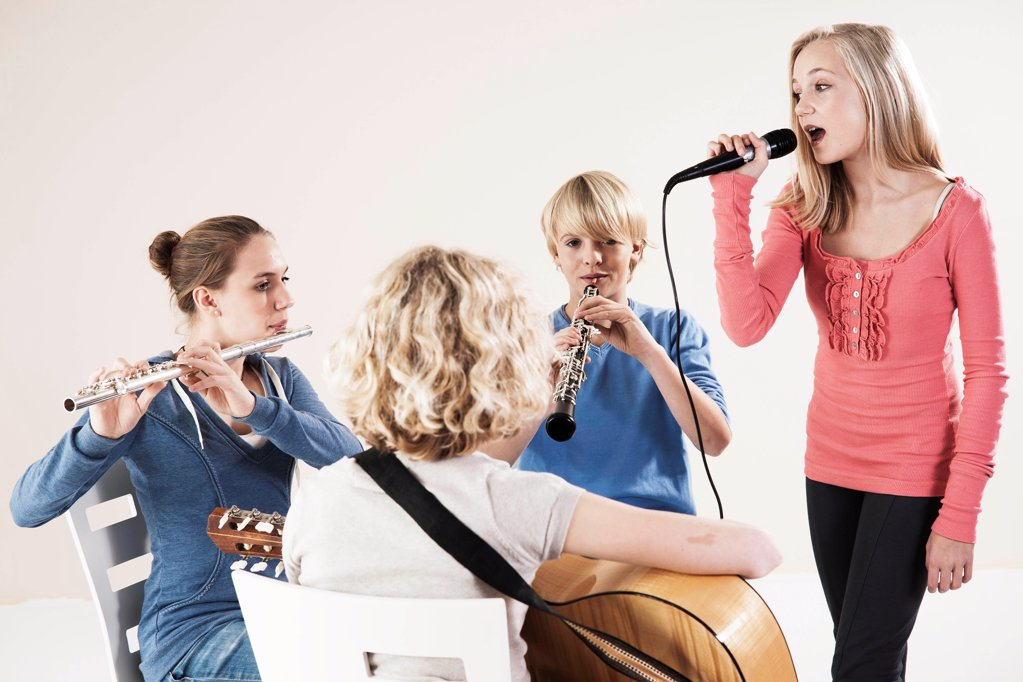 Stock Photo: 1841R-125139 Teenager playing music