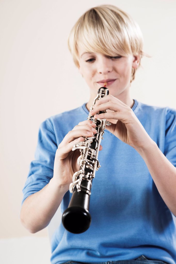 Stock Photo: 1841R-125140 Teenage boy playing oboe