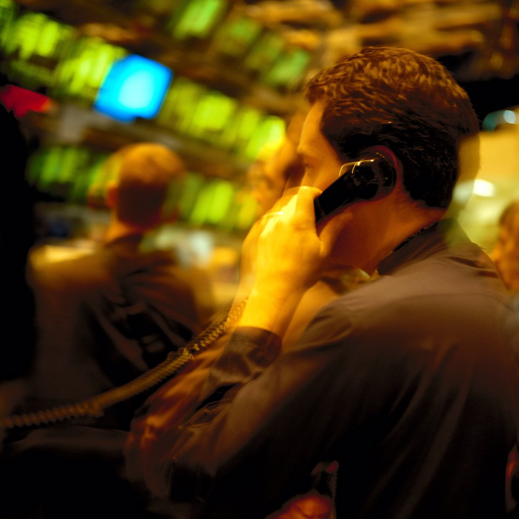 Broker on phone : Stock Photo