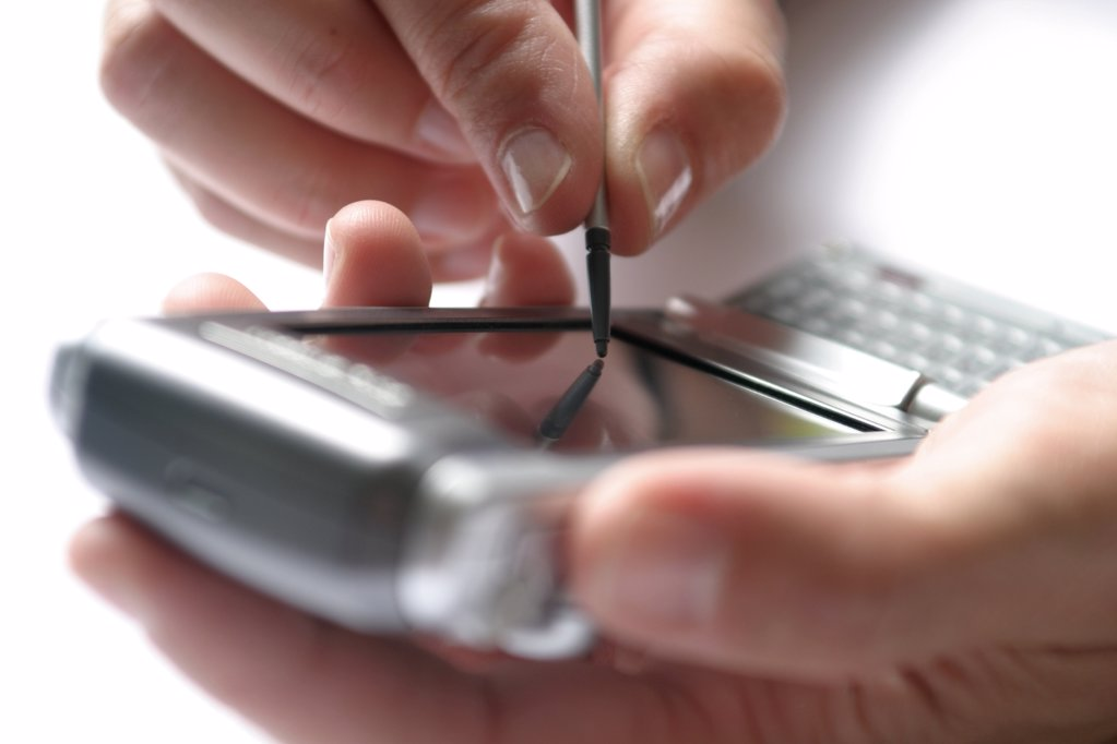Close-up of person's hand using palmtop : Stock Photo