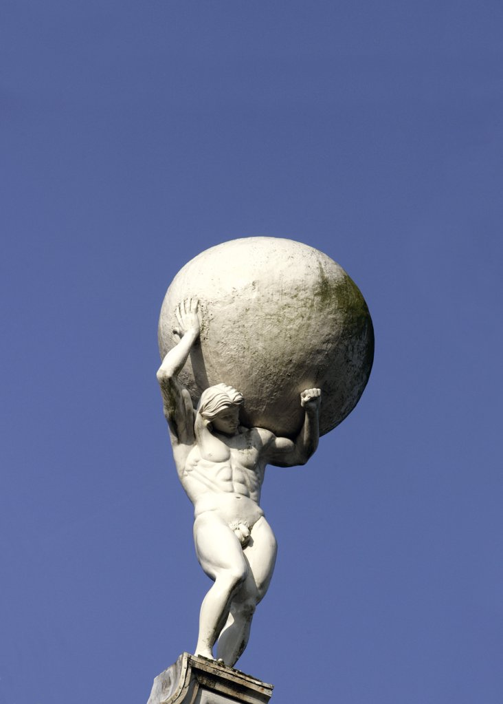 Stock Photo: 1841R-81473 Low angle view of statue of man carrying globe