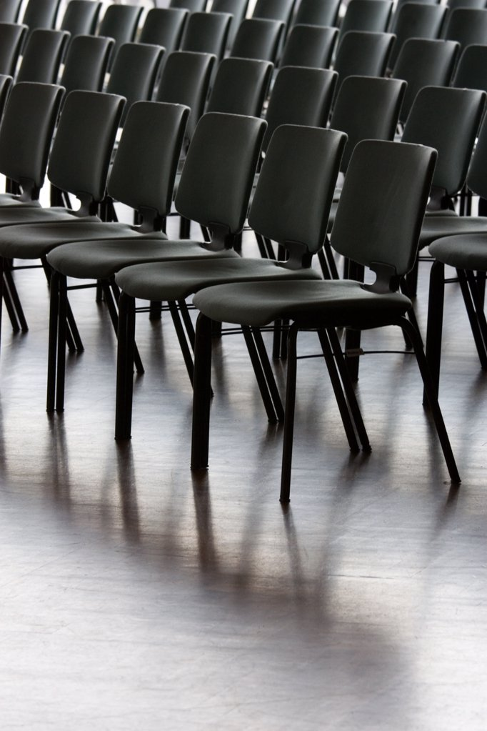 Empty chairs arranged in row : Stock Photo
