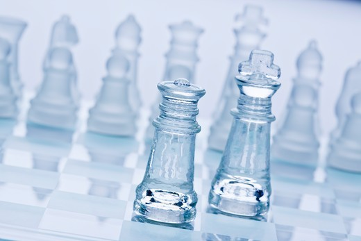Glass chess board and pieces, close-up : Stock Photo