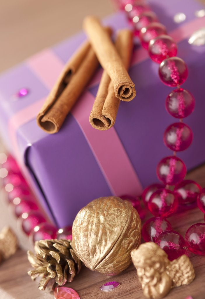 Wrapped present and christmas decoration, high angle view, close-up : Stock Photo