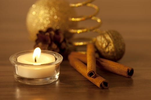 Burning candle and christmas decoration, close-up : Stock Photo