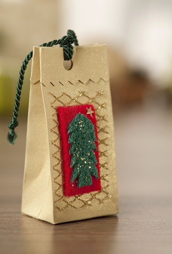 Decorated gift bag made of felt, close-up : Stock Photo