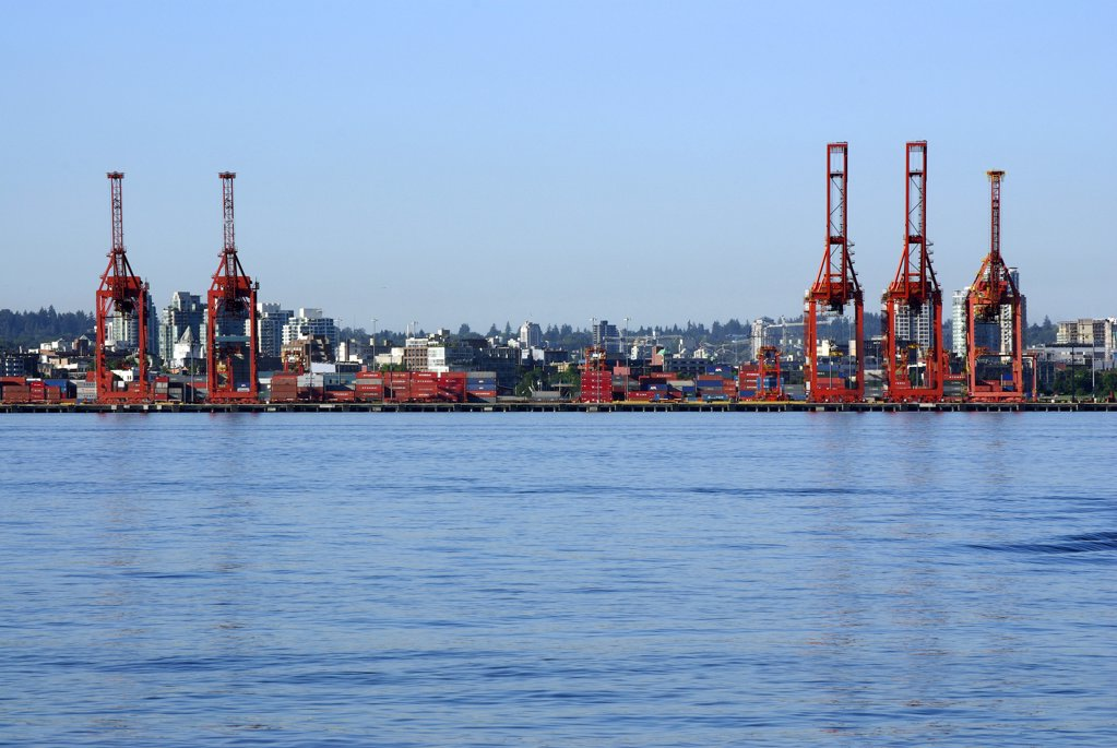 Container cargo loaded by gantry, shipping terminal, Port of Vancouver : Stock Photo