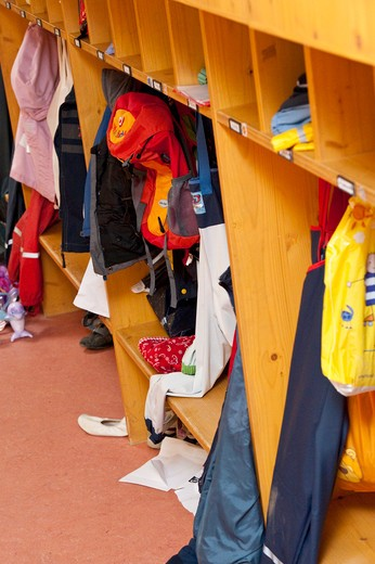 Clothes in the cloakroom of a kindergarten : Stock Photo