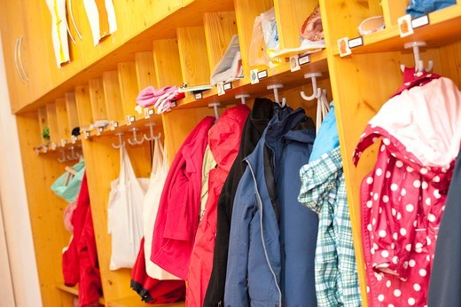 Stock Photo: 1841R-83909 Clothes hanging in the cloakroom of a kindergarten