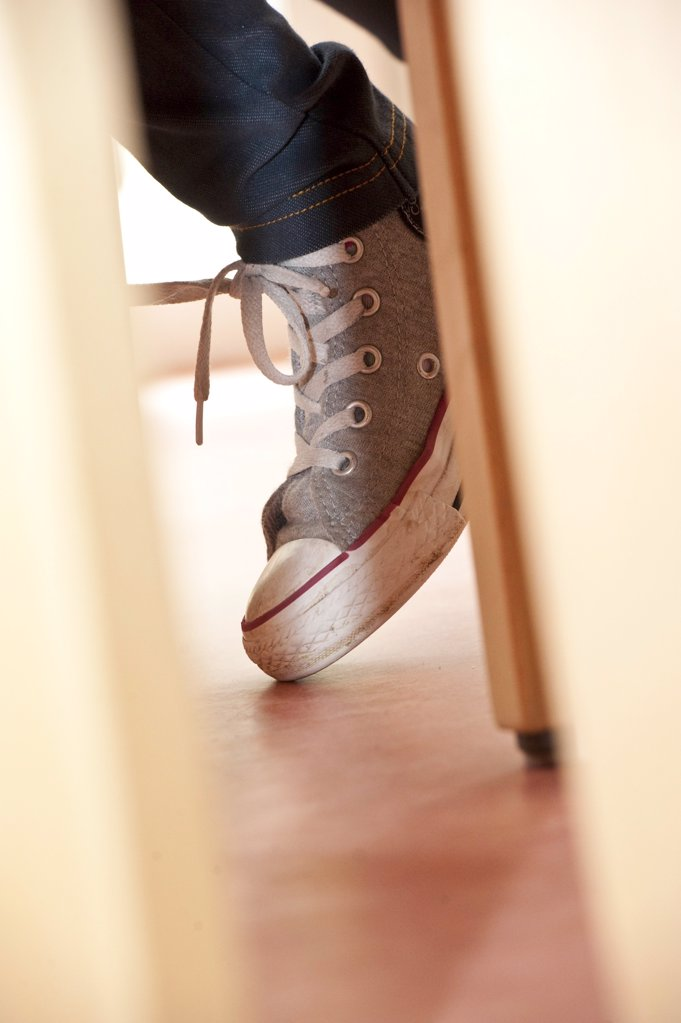 Legs under a table, close-up : Stock Photo