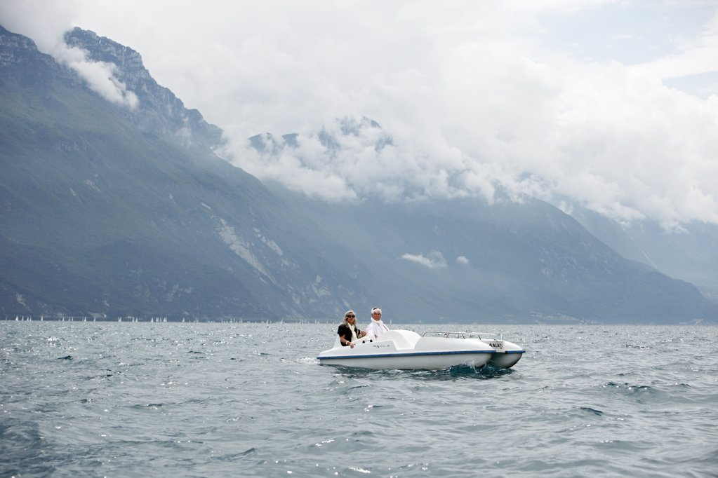 Senior couple with pedal boat in mountain scenery, Italy : Stock Photo