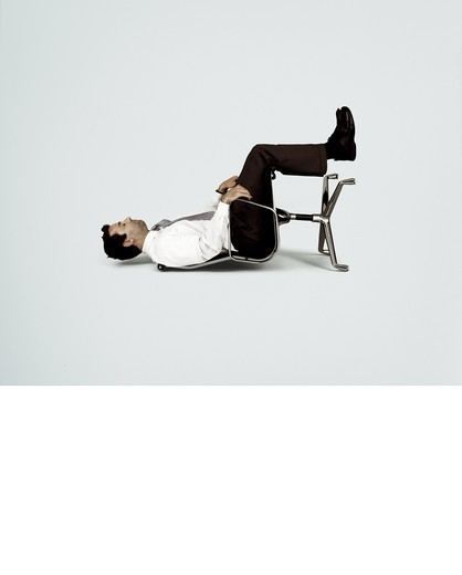 Stock Photo: 1841R-88145 Side profile of businessman sitting on fallen chair