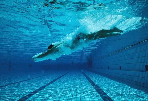 Stock Photo: 1841R-88541 Man swimming underwater