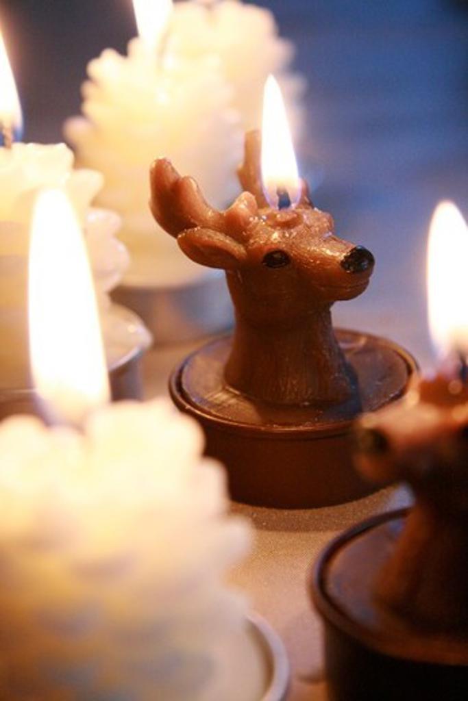 Close-up of burning Christmas candle : Stock Photo