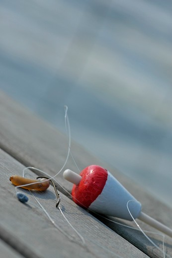 Stock Photo: 1841R-89675 Close-up of fishing equipment on wooden plank