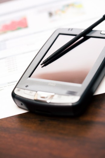 Close-up of stylus on mobile phone : Stock Photo