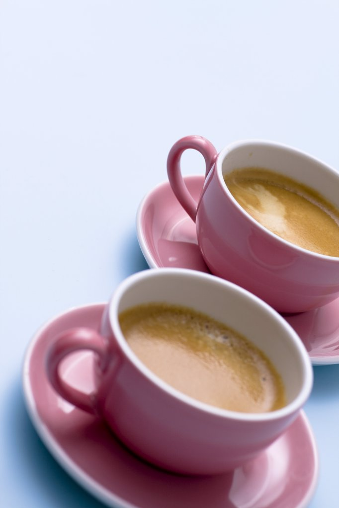 Close-up of two cups of tea on saucers : Stock Photo