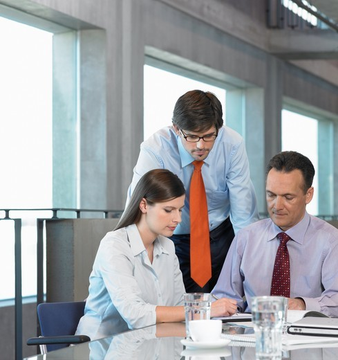 Three businesspeople discussing in meeting : Stock Photo