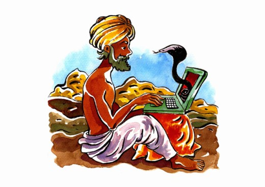 Indian snake-charmer with a turban on his laptop : Stock Photo