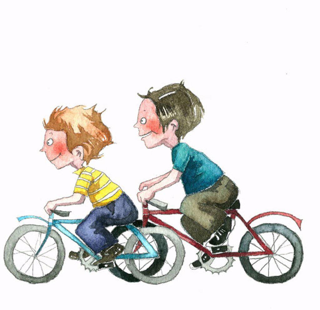 Two boys speeding on bicycles : Stock Photo
