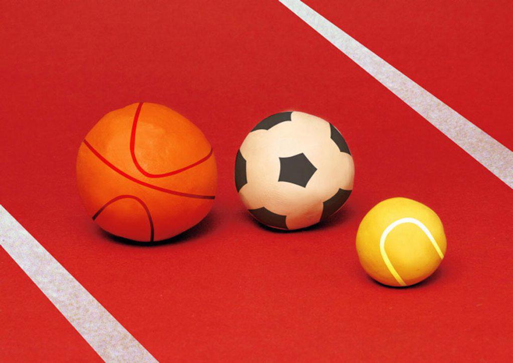 Stock Photo: 1843R-3230 A basketball, a soccer ball, and a tennis ball