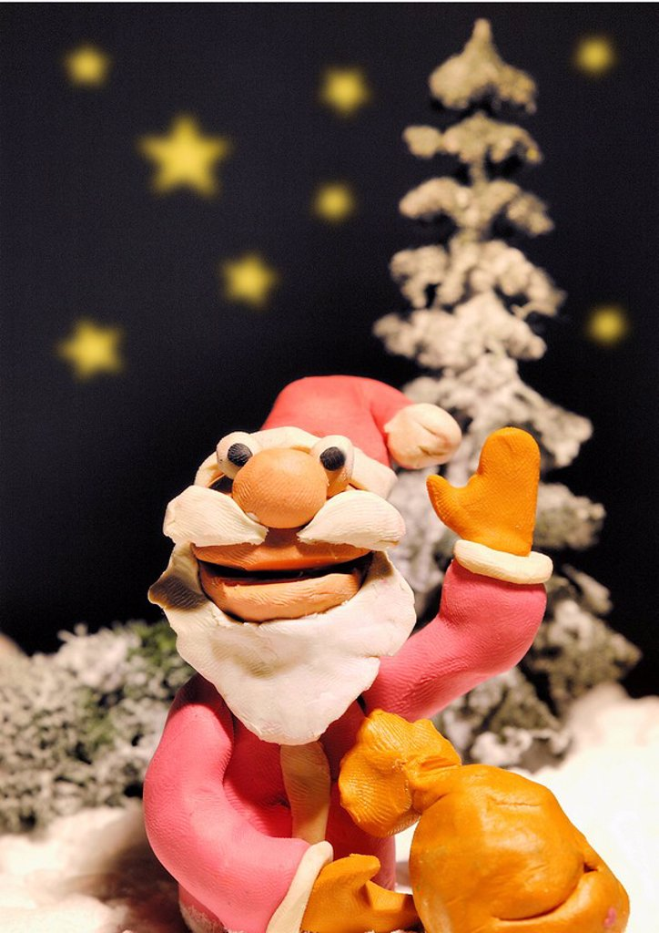 Stock Photo: 1843R-3276 Santa Claus with bag of presents