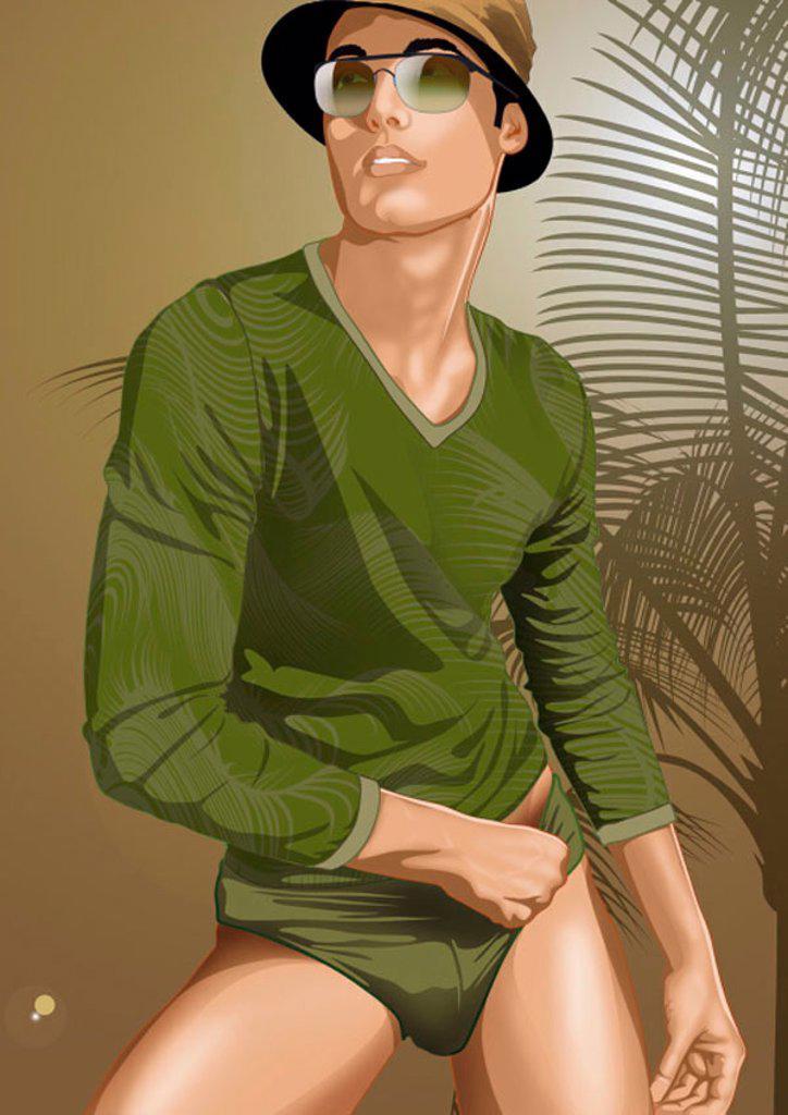 Young man posing cross-legged in a tropical setting : Stock Photo