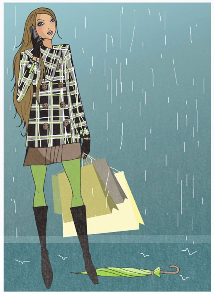Stock Photo: 1843R-3388 Woman caught in the rain with her shopping bags talking on the mobile phone