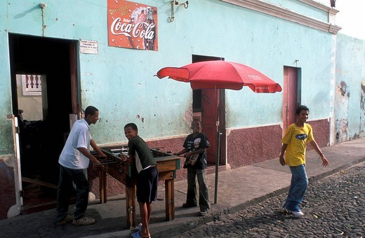 Stock Photo: 1844-1782 Sao Filipe, boys playing table football on street , Fogo, Cape Verde, Africa