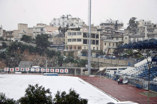 Snowing in the municipal stadium of Kallithea, Athens, Attica, Greece, Europe : Stock Photo