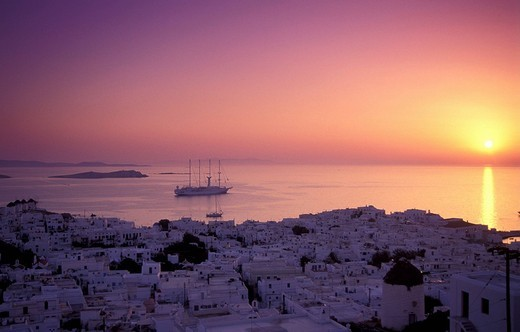 Stock Photo: 1844-6201 Cyclades, Mykonos Hora, general view of the town & sea at sunset, ship