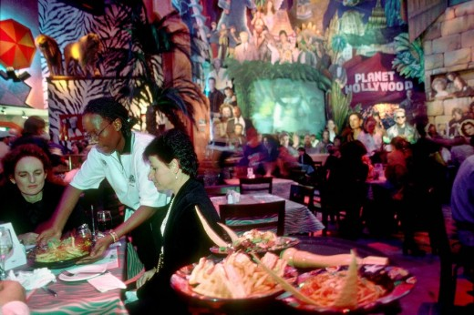 Stock Photo: 1844-6532 Waitress serving food at Planet Hollywood. Cape Town, South Africa, Africa.
