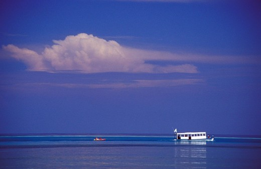 The Club Med boat in calm emerald seas of the lagoon, Maldives, Asia : Stock Photo