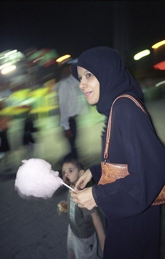 Stock Photo: 1844-9161 King Faisal cornice  Amusement park, at the sea-side  Traditional Muslim young mother with her child  Manama, Bahrain, Middle east