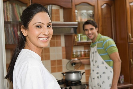 Couple cooking food in the kitchen : Stock Photo