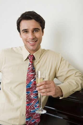 Man drinking champagne : Stock Photo
