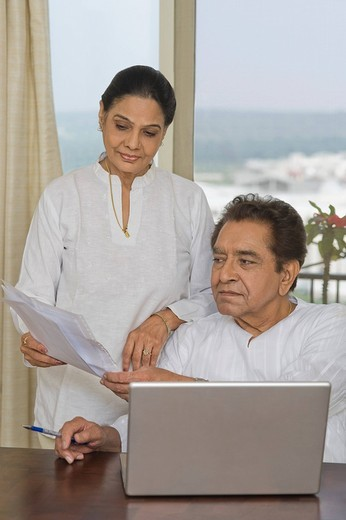 Stock Photo: 1846-10500 Couple sorting out bills