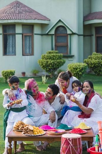 Stock Photo: 1846-10760 Family celebrating Holi