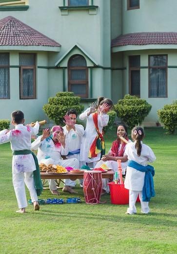 Stock Photo: 1846-10763 Family celebrating Holi