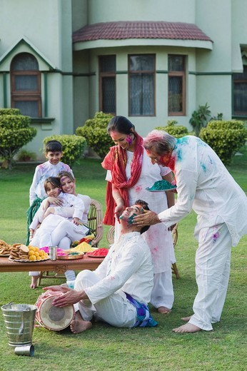 Stock Photo: 1846-10783 Family celebrating Holi