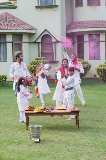 Stock Photo: 1846-10830 Family celebrating Holi