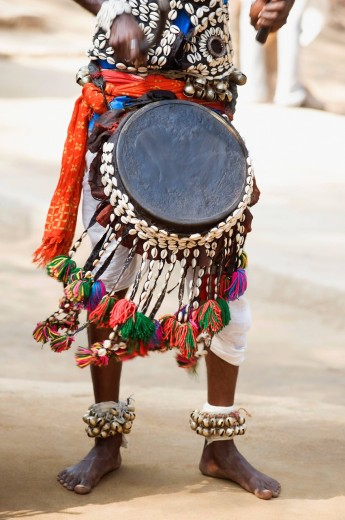 Traditional Indian folk musician playing a drum in a fair, Surajkund Crafts Mela, Surajkund, Haryana, India : Stock Photo