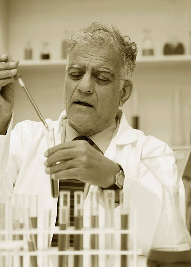 Scientist doing scientific experiment in a laboratory : Stock Photo