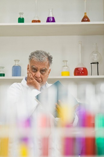 Scientist thinking in a laboratory : Stock Photo