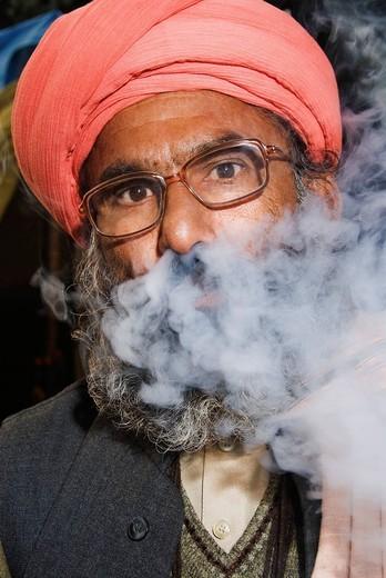 Close_up of a sadhu smoking a chilam, Haridwar, Uttarakhand, India : Stock Photo