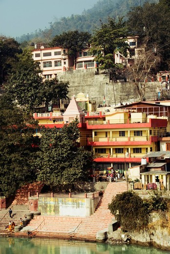 Stock Photo: 1846-11632 Buildings and temples at the waterfront, Ganges River, Rishikesh, Dehradun District, Uttarakhand, India