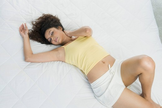 High angle view of a woman sleeping on the bed : Stock Photo