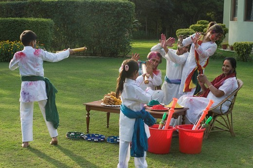 Family celebrating Holi : Stock Photo