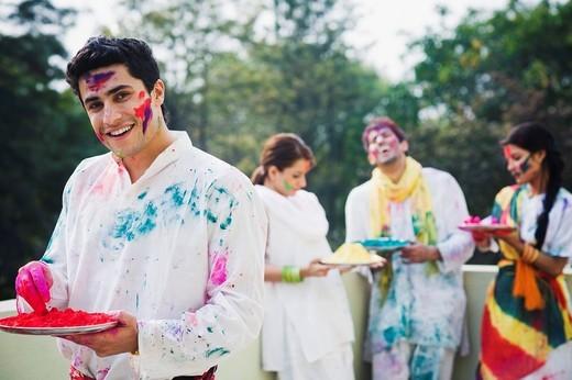 Stock Photo: 1846-11950 Friends celebrating Holi