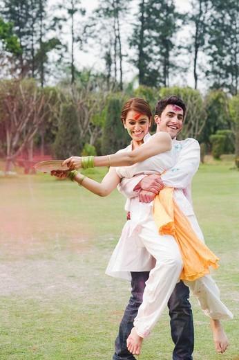 Stock Photo: 1846-11976 Couple celebrating Holi